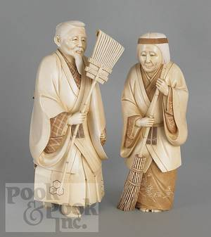 Pair of Japanese carved ivory figures of a man and woman