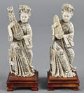 Pair of Chinese carved ivory figures of women playing instruments