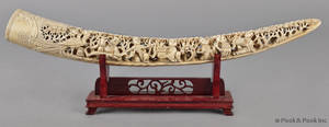 Chinese carved ivory tusk with ten figures and a dragon motif