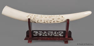 Chinese carved ivory tusk with dragon in cloud motif