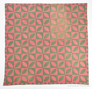 Pieced green and pink calico quilt