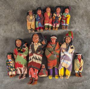 Group of twelve Native American skookum dolls