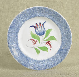 Blue spatter plate with tulip decoration
