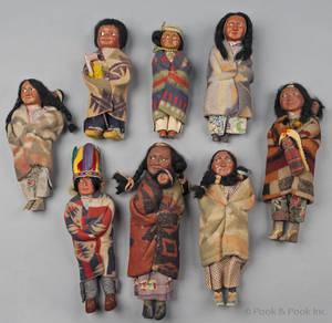 Group of eight Native American skookum dolls
