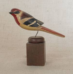 Carved and painted song bird on a wooden mount late 19th c