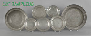 Twelve continental pewter plates and chargers