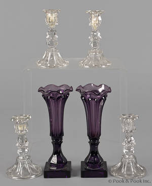 Set of four colorless glass candlesticks