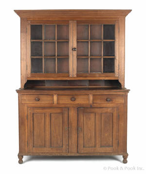 Pennsylvania walnut twopart Dutch cupboard ca 1810