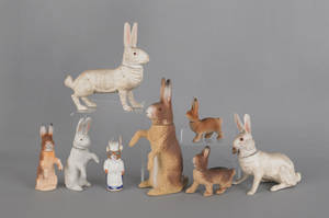 Eight composition rabbit candy containers