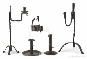 Two wrought iron rush light holders