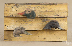 Three carved and painted duck decoy heads