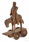 Carved pine articulated Hessian soldier on horseback pull toy
