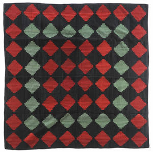 Contemporary Amish log cabin quilt
