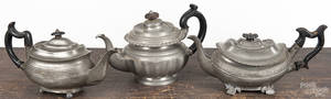 Three pewter teapots