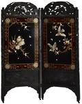 Chinese carved and ebonized dressing screen