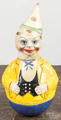 Two composition clown roly poly toys