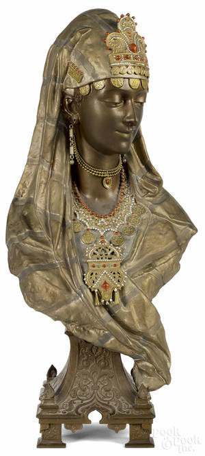Painted spelter bust of a woman
