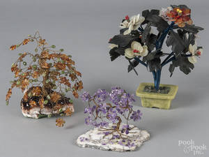 Three Chinese hardstone and wire flowering trees with decorative stone bases