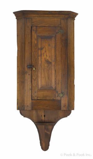 Pennsylvania walnut hanging corner cupboard early 19th c