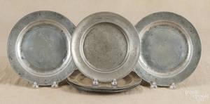 Set of six pewter plates