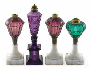 Four New England pressed glass fluid lamps mid 19th c