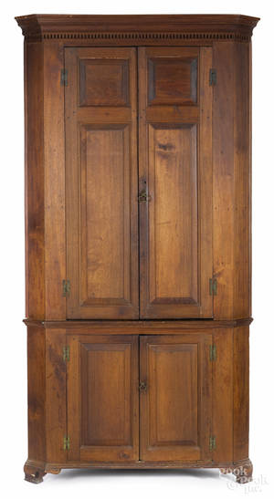 Pennsylvania walnut twopart corner cupboard late 18th c