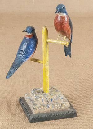 Keith Collis carved and painted bluebirds on a perch