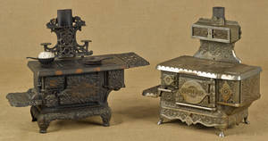 Two cast iron and nickel toy stoves