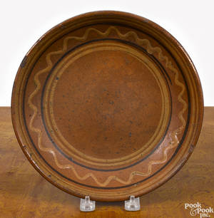 Pennsylvania redware shallow bowl early 19th c