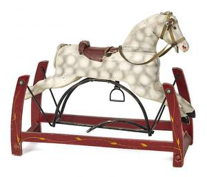 Carved and painted rocking horse
