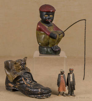 Cement lawn figure of a black Americana boy fishing