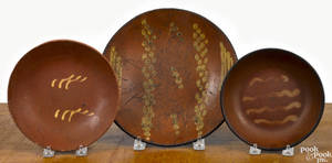 Three Pennsylvania redware plates 19th c