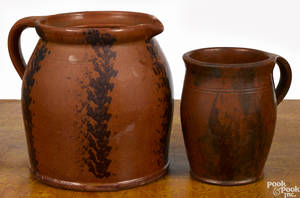 Two Pennsylvania redware pitchers 19th c