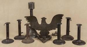 Six tin hogscraper candlesticks