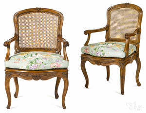 Pair of French Louis XV carved fruitwood fauteuils 19th c