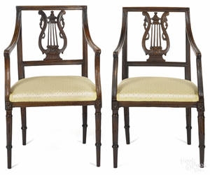 Pair of French Directoire fruitwood armchairs early 19th c