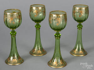 Set of four emerald glass wines with gilt decoration