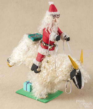 Carved and painted outsider art figure of Santa Claus riding a sheep