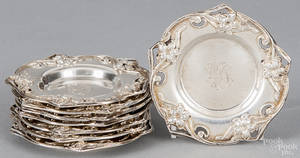 Set of eight Dominick and Haff sterling silver condiment dishes with art nouveau floral borders