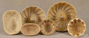 Seven yelloware food molds