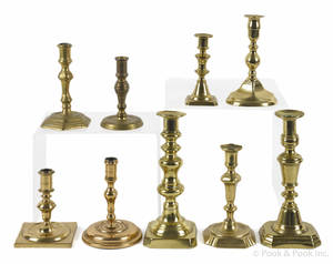 Nine early brass candlesticks