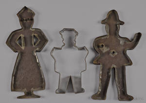 Pair of large tin cookie cutters of a man and woman