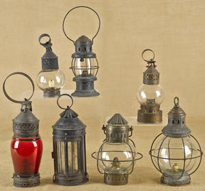 Seven brass and tin carry lanterns 19th c