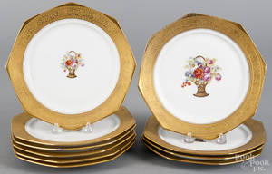 Set of ten Krautheim porcelain plates with a central basket of flowers and a gilt border