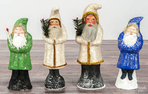 Four contemporary chalkware belsnickle Santa Claus figures
