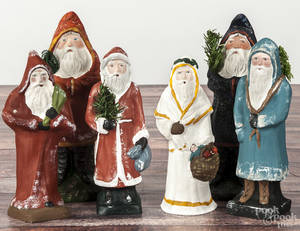 Six contemporary chalkware belsnickle Santa Claus figures