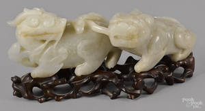 Chinese carved white jade foo lion group