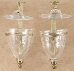 Pair of brass wall sconces with colorless glass shades
