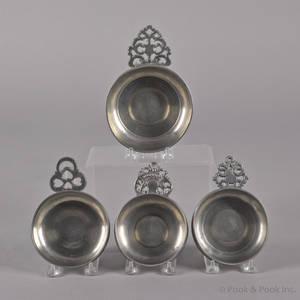 Four New England pewter porringers ca 1800