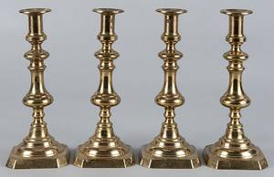 Set of four English brass candlesticks